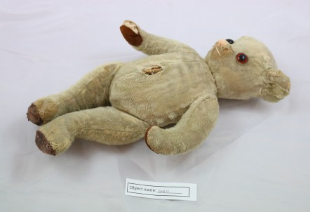 EMB13: a teddy bear called Titi, made in the early 20th century. The eyes are made of glass, and it is thought he was originally stuffed with straw (now replaced with kapok). He used to have a growl, and is fully jointed.