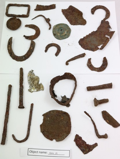 EMB18: collection of objects found in a sealed up bread oven in a cottage in Embsay. The oven may have been sealed for over 50 years. This collection of metal objects (including clog irons) is just a sample of the large amount of objects found (collection also includes leather fragments, wooden objects, skittles, clay marbles, wooden objects etc.)