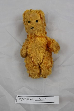 EMB9: teddy bear made with mohair fur, stuffed with thin wood shavings. The eyes are made from glass