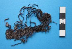 Dark brown woollen Bronze Age cloth, found in a barrow containing a tree trunk coffin burial