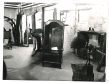1960s: downstairs in the Museum (3/3) A photo of one of the exhibit areas in the basement, including a Hall Porters chair from John Wesley (a local preacher) and the besom engine on the right.