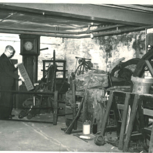 1960s: downstairs in the Museum (2/3) This photo shows the new basement room in the Library that was used to store and sometimes exhibit some of the Museum collection. Here, one of the long case clocks can be seen on the left, and the penny farthing is in the background.