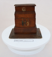 ING3: This is a money box in the shape of the Cenotaph, and was purchased online. It forms part of the owner's WW1 collection, which also includes many postcards from the era.