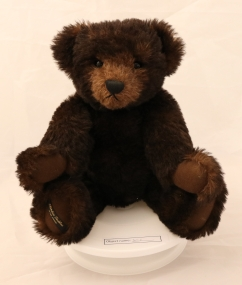 SET1: This bear is 40-45 years old, and was given to the owner's family. Her husband was a sewing machine mechanic, and one of the women he worked for in the Nelson area made teddy bears by hand as a hobby in the design of Steiff. The bottom of his right foot has the makers name, and he has fully jointed limbs, and a working growl.