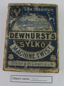 SET2: This is a museum object, but a visitor had some interesting stories to tell about Dewhurst's Mill, featured on this box. She worked for Dewhurst's 1975-80 in the job of Spring Winding. This involved taking a spring for one of the machines and rolling it up into a piece of paper. The spring was then put onto the machine, and it wrapped the cotton round the spring (all the machinery was still moving while this happened). If the cotton broke, then a handheld knotting machine was used to reknot it. She had to make sure none of the springs had run out, or she would lose money (like piecework). When the cotton winding process was finished, the reels were put in a storage box, and taken to be dyed.
