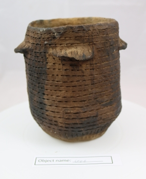 CRO6 (1:) Flat based Neolithic pot replica, modelled off a pot from the Outer Hebrides. This one has been used to cook stews, hence the discolouration on the outside.