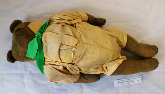 CRO7: This is a photo of a teddy from Craven Museum's collection, but inspired a story from one of our visitors, Sue, about her own very similar teddy. Sue's teddy is around 60 years old, and like this bear has a woodchip stuffing and movable joints. Her Mum knitted him an outfit, and the trousers survive to this day!
