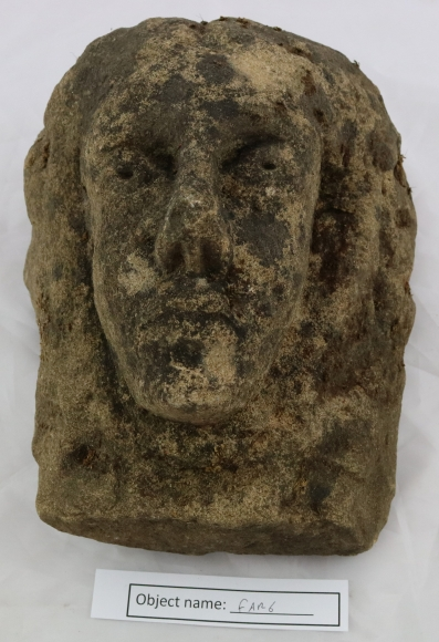 FAR6: Carved stone head found in Farnhill. It was built into the wall of an ancient head in the owner's garden. It was built in with the nose facing down, and was found when the shed was pulled down.