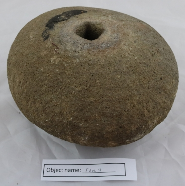 FAR7: Round stone with a hole in the middle, not dissimilar from a quern stone. Part of a pair in the owner's garden, which to their knowledge have been there since the family moved in in 1820. This one weighs 11.5 lbs, the other 13.3 lbs.