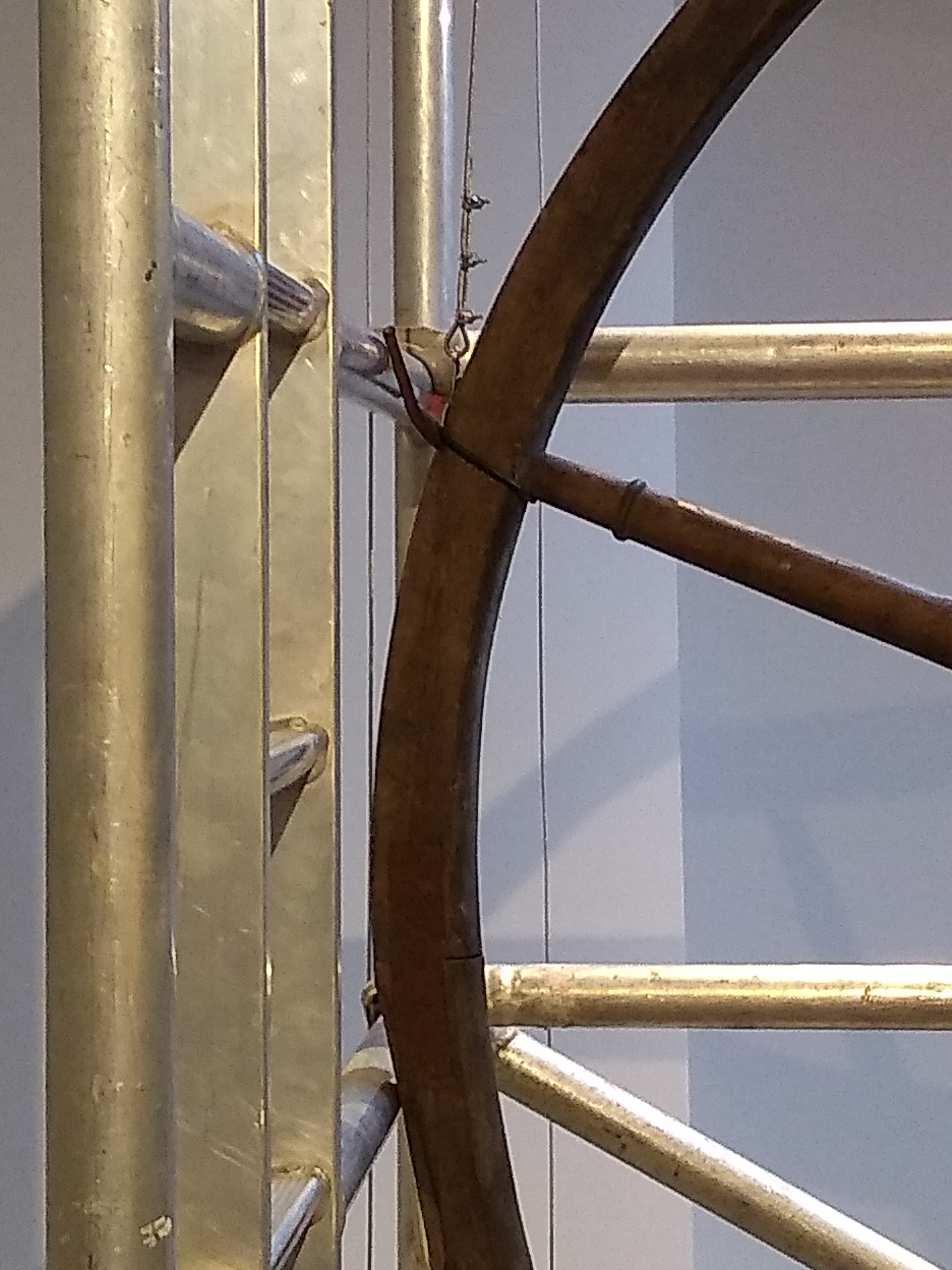 Scaffolding supporting a wheel from the collection.
